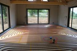 Mise en place plancher chauffant