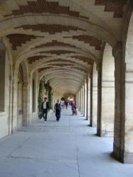 Under the arcades, Place des Vosges, Paris