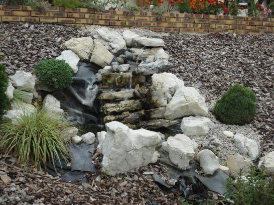 amenagement paysager d une butte superbe amenagement jardin paysagiste glycines limiter les. Black Bedroom Furniture Sets. Home Design Ideas